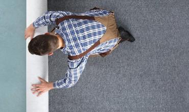 Man rolling Carpet | Floorida Floors
