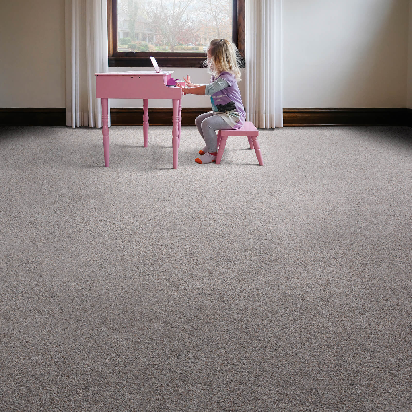 Girl with piano on Carpet flooring | Floorida Floors