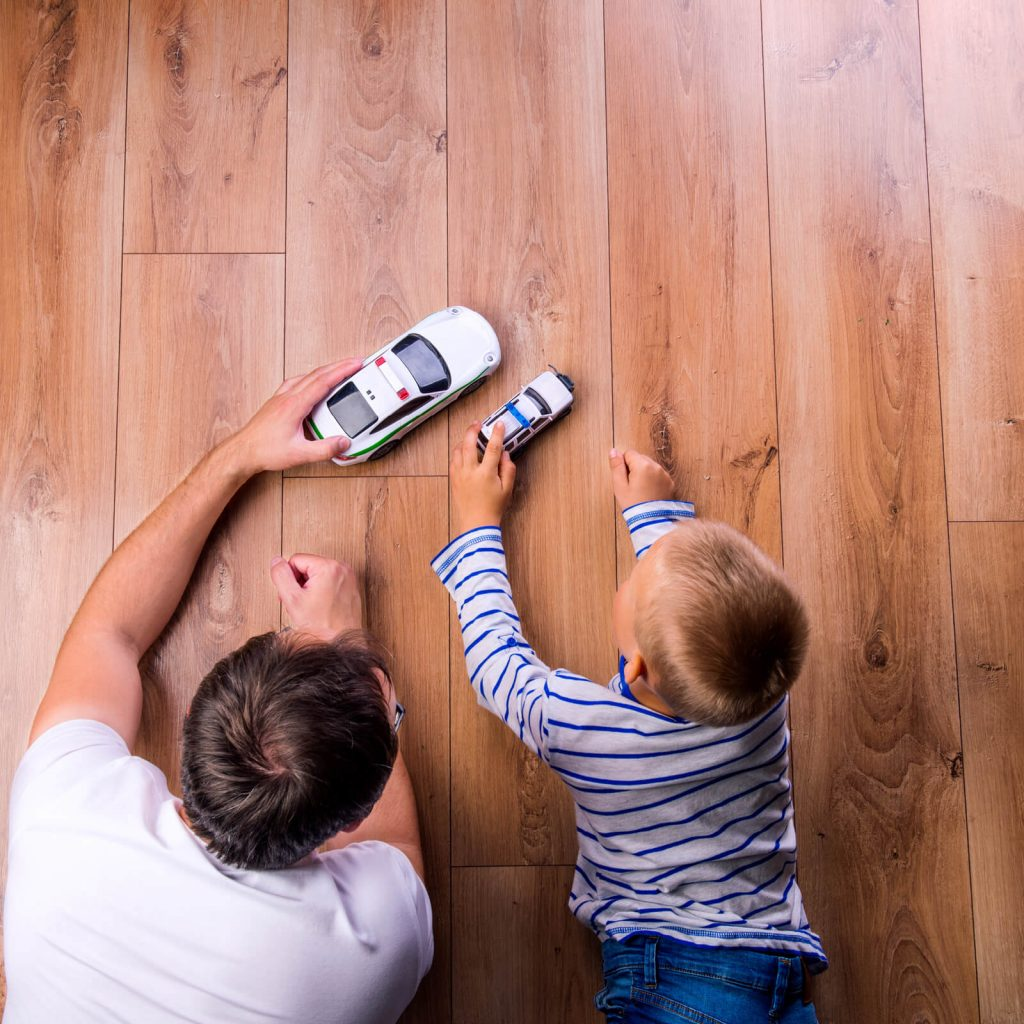 Father and kid playing with toycar | Floorida Floors