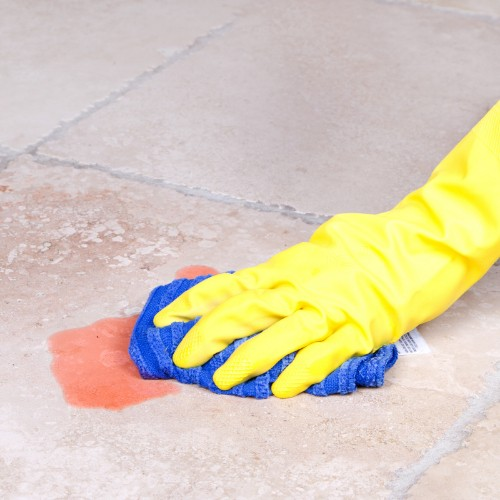 Cleaning spill on tile in Tallahassee, FL | Floorida Floors